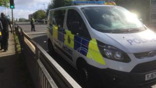 Police van at the scene in Burmantofts Street
