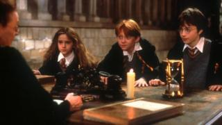 Emma Watson, Rupert Grint and Daniel Radcliffe as Hermione Granger, Ron Weasley and Harry Potter