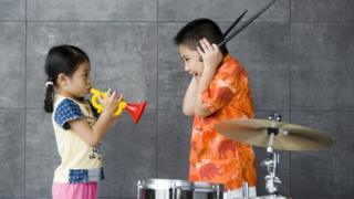 Stock photo of children playing music