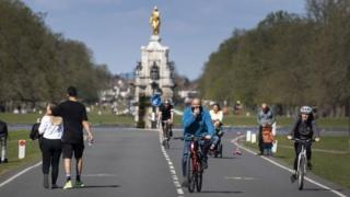 Cyclists and walkers in Bushy Park in London on Saturday 4 April