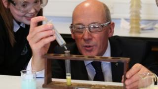 John Swinney in science classroom