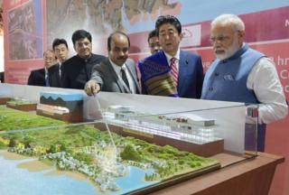 "This handout photograph released by India""s Press Information Bureau (PIB) on September 14, 2017 shows Indian Prime Minister Narendra Modi (L) and Japanese Prime Minister Shinzo Abe looking at a railway station model at a ground breaking ceremony for the Mumbai-Ahmedabad high speed rail project in Ahmedabad. India""s first bullet train project, a $19-billion initiative linking Ahmedabad to Mumbai, was launched September 14"