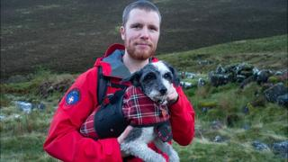 Keswick Mountain Rescue Team member with tired terrier