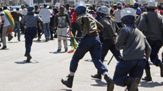 Police chasing protesters in Harare, Zimbabwe - Wednesday 3 August 2016