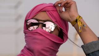 in_pictures A woman in a pink head scarf with reflective sunglasses dances at the Dunes Electronique music festival in Ong Jmal, Tunisia - Saturday 16 November 2019