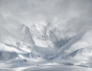 A landscape view of snow-covered mountains