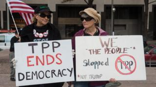 Protestors with anti-TPP signs