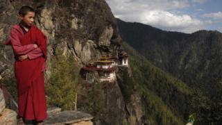 A boy monk on a mountainside