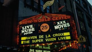 A neon sign for Live Nude review in New York's Show World centre