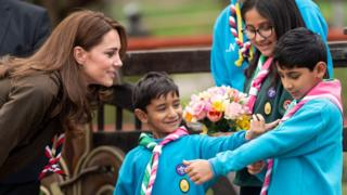 The Duchess of Cambridge with children on a visit to Scouts HQ in Gilwell Park, Essex, in March 2019