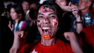An NLD supporter celebrates the election win in Yangon (9 Nov 2015)
