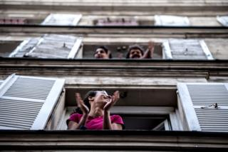 Parisians applauding from their window