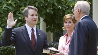 Brett Kavanaugh is sworn in by Justice Anthony Kennedy
