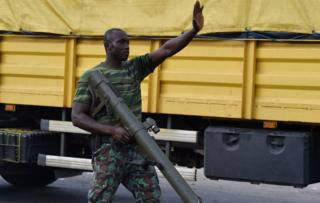 A mutinous soldier patrols in the streets of Ivory Coast's central second city Bouake, in May 14, 2017