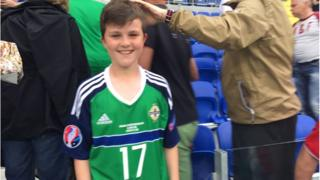 Matthew proudly wearing Paddy McNair's jersey after the match on Thursday.