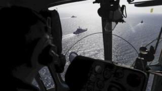 Russian navy ships are viewed through a military helicopter's window during military drills at the Black Sea coast, Crimea (09 September 2016)