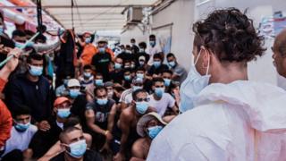 Migrants wearing masks onboard the Ocean Viking