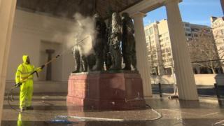 memorial being cleaned