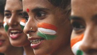 Women from the Vandemataram social organisation paint themselves in the tricolor flag of India for Independence Day in 2016.