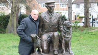 Paul Nicholls with the statue