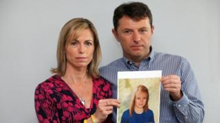 Kate and Gerry McCann pose with a computer generated image of how their missing daughter Madeleine might have looked in 2012