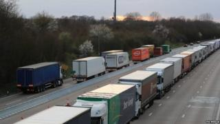 Lorries queue on the A20 outside Dover in Kent where Operation Stack is being implemented