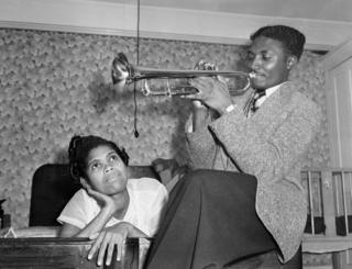 Keith Edwards and Queenie Marques, immigrants from Jamaica, are seen in a bedroom in 1954