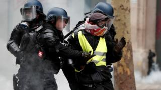 "French officers apprehend a protester during a ""yellow vest"" demonstration in Paris, 8 December"