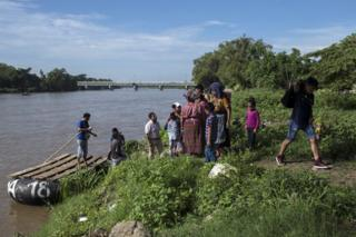 Migrants arrive in Mexico after crossing the Suchiate River