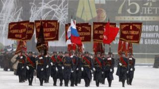 Honour guards carry the banners of the Soviet Fronts that fought for Leningrad during World War Two. Photo: 27 January 2019