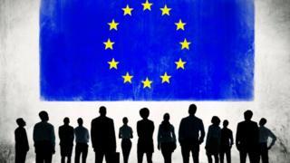 EU flag and businesspeople