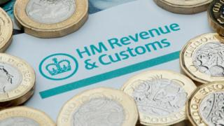 HM Revenue and Customs logo surrounded by coins