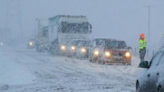 Vehicles in snow in Cumbria