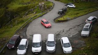 Tourists' cars parked at the Quiraing
