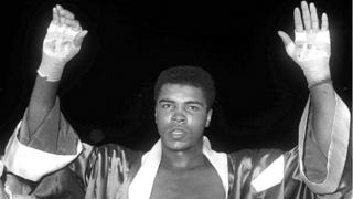 Boxing legend Muhammad Ali with his hands aloft, file pic from 18 November 1963