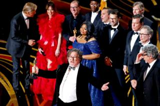 Green Book producer Charles Wessler on stage with cast and crew