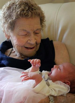 Vera Sommerfeld, 96, of Lethbridge, Canada, is pictured holding her baby great-great-great-grandaughter, Callie Marsh
