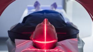 Patient undergoing medical testing using lasers