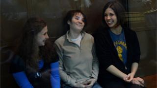 From left to right, Yekaterina Samutsevich, Maria Alyokhina and Nadezhda Tolokonnikova sit
