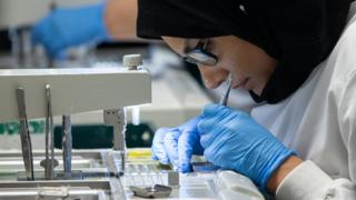 Woman analysing human tissue cells