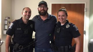 John Ogburn with the police officers who saved him, Lawrence Guiler (L) and Nikolina Bajic