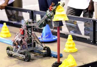 A robot performs during the final of the national robotics competition on May 20, 2017 at the Marius Ndaye stadium in the Senegalese capital Dakar