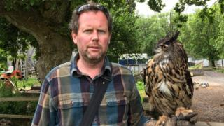 Welsh Hawking Centre boss Jamie Munro with Buzz the European Eagle Owl