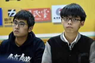 Joshua Wong (R), the teenage face of Hong Kong's Umbrella Movement which brought parts of the city to a standstill in 2014, listens with fellow Hong Kong student leader Alex Chow during a press conference in Taipei on 17 January 2016.