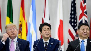 US President Donald Trump, Japan's Prime Minister Shinzo Abe and China's President Xi Jinping attend a meeting at the G20 Summit in Osaka