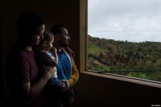 "Wilfredo ""Junny"" Ruiz Feliciano, 52, his son William Ruiz Pacheco, 28 and grandson William Sebastian Ruiz on their farm"