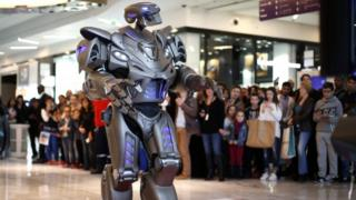 Titan, a robot created by Cyberstein Robots Ltd., performs during a promotional event at the Qwartz shopping centre in Villeneuve-la-Garenne, near Paris