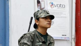 "Peruvian soldier patrol a polling station after workers of Peru""s National Office of Electoral Processes (ONPE) leave voting materials, in Surco"