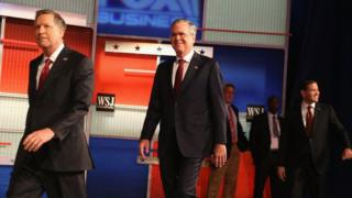 Candidates walk onto the stage at the Republican debate in Milwaukee.
