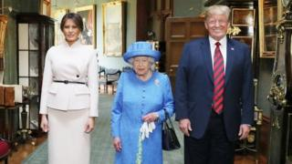 Queen Elizabeth II stands with US President Donald Trump and his wife, Melania, in the Grand Corridor during their visit to Windsor Castle